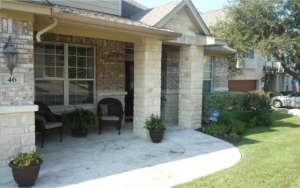 Completed stone sidewalk porch