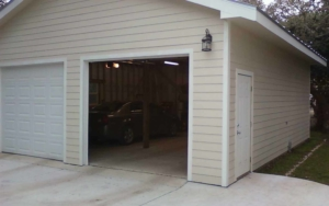Detached garage building with vehicles inside