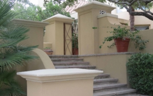 Exterior stucco staircase with wall
