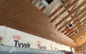 Interior view of a ceiling getting a new wood slat cover