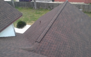 Looking down view of the house with maroon shingles