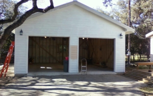Newly constructed detached garage with doors open