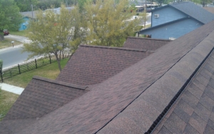 Overhead view of house with maroon colored shingles