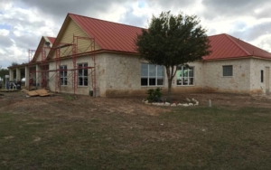 Rear view of the home getting a pool addition