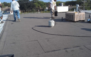 TWT workers on top of a commercial rooftop